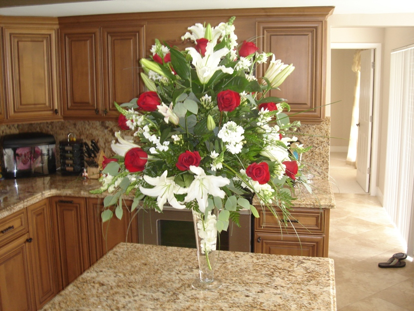 Red And White Flowers Arrangements In Tall Vase For Church