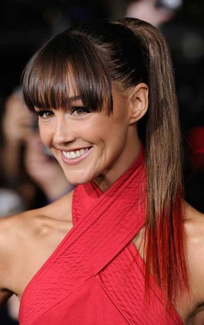 Sleek Ponytail Hairstyle with Bangs for Black Women