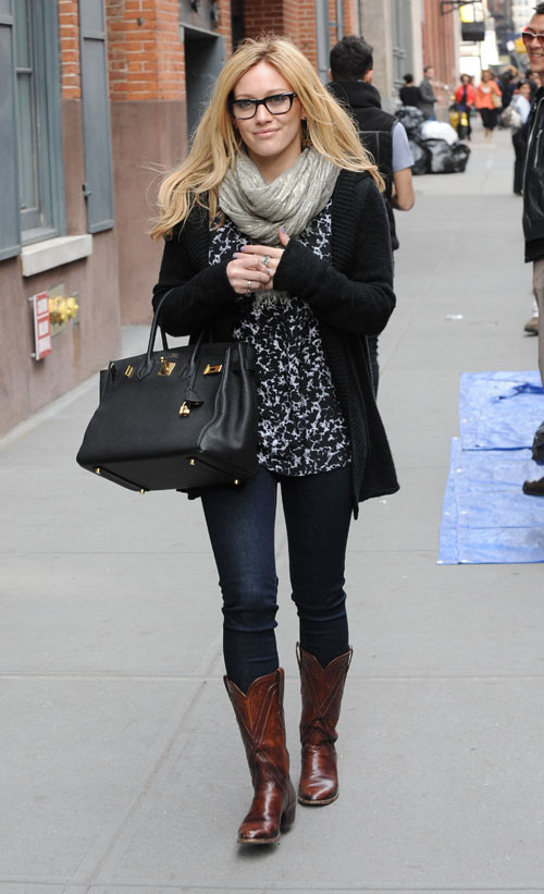Miranda Lambert wearing Cowboy Boots with straight leg jeans with cardigan