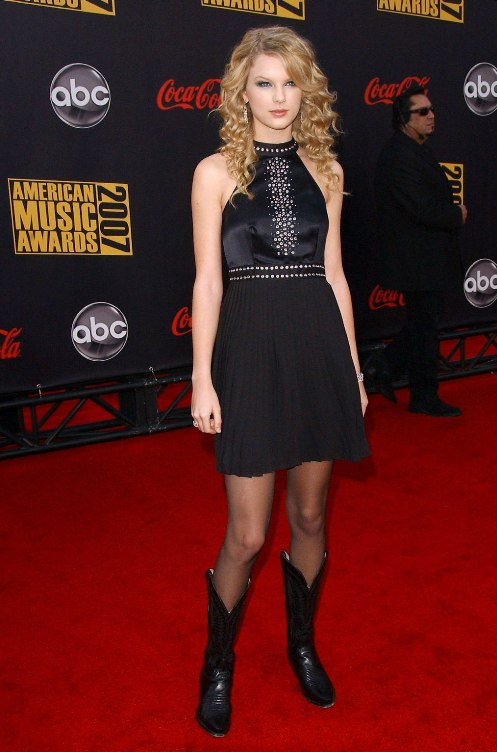 Taylor Swift in Short Skirt with Cowboy Boots
